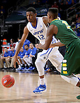 SIOUX FALLS, SD - MARCH 7: Michale Calder #12 of Fort Wayne and Carlin Dupree #3 of North Dakota State go for a loose ball in the 2016 Summit League Tournament.   (Photo by Dave Eggen/Inertia)