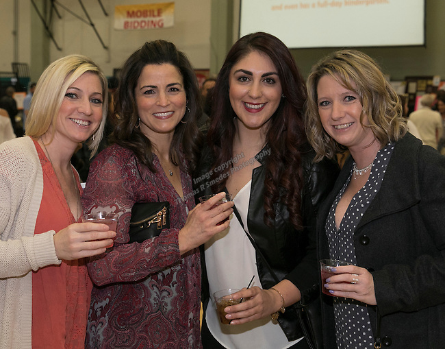 Ashley Gotta, Carrie Taylor, Elyse Sambrano and Morgan Barr during the Jack T. Reviglio Cioppino Feed & Auction at the Donald W. Reynolds Facility in Reno on Saturday, February 25, 2017.