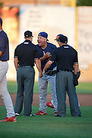 State College Spikes manager Joe Kruzel (13) argues a call with umpires Ben Rosen (left) and Scott Molloy (right) during a game against the Auburn Doubledays on August 21, 2017 at Falcon Park in Auburn, New York.  Kruzel was ejected from the game.  Auburn defeated State College 6-1.  (Mike Janes/Four Seam Images)