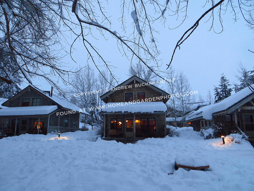 A well-lit cabin offers warm shelter on a snowy evening in the Methow Valley, Washington.
