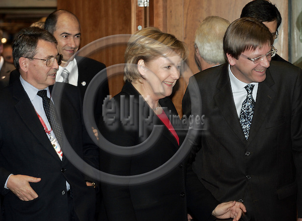 BRUSSELS - BELGIUM - 14 DECEMBER 2006 -- EU-Summit hosted by the Finnish Presidency. -- The German Chancellor Angela MERKEL entering with Guy VERHOFSTADT the Prime Minister of Belgium. -- PHOTO: JUHA ROININEN / EUP-IMAGES
