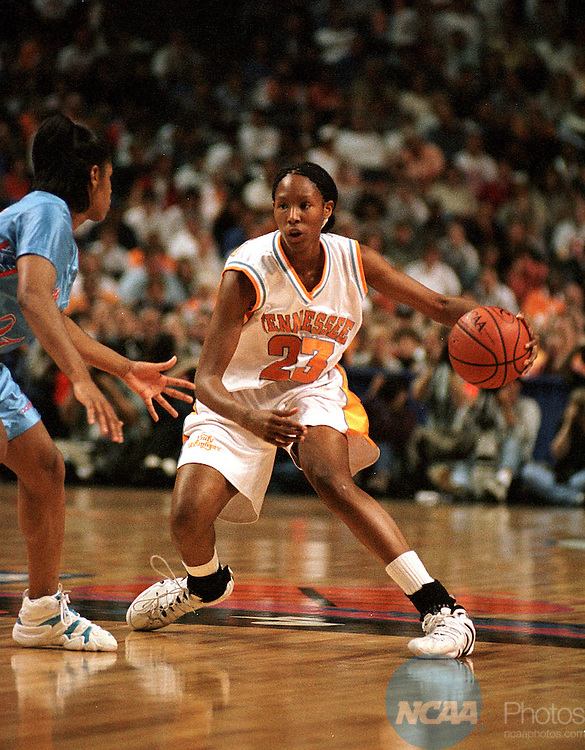 Caption: 29 MAR 1998: Forward Chamique Holdsclaw (23) of Tennessee attempts to dribble around her Louisiana Tech opponent during the Division I Women's Basketball Championships held at Kemper Arena in Kansas City, MO. The Lady Vols of Tennessee went on to defeat the Lady Techsters of Louisiana Tech 93-75 for the championship. Ryan McKee/NCAA Photos.