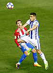 Atletico de Madrid's Antoine Griezmann (l) and Real Sociedad's Yuri Berchiche during La Liga match. April 4,2017. (ALTERPHOTOS/Acero)