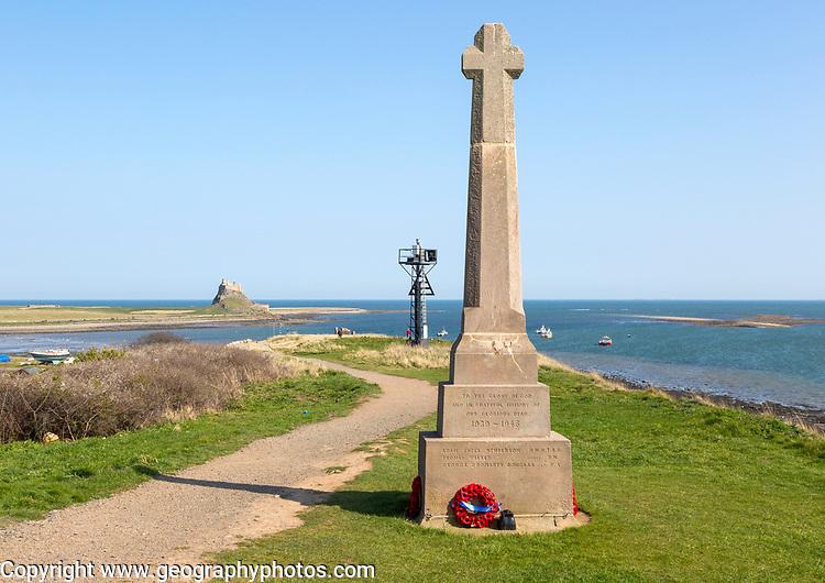 War memorial and Lindisfarne castle North Sea coast, Holy Island, Northumberland, England, UK
