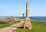 War memorial and Lindisfarne castle North Sea coast, Holy Island, Northumberland, England, UK