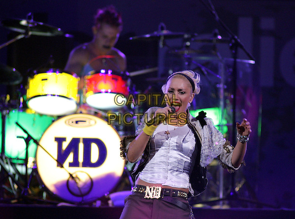 NO DOUBT -  GWEN STEFANI.Live at The Music for Relief Tsunami Benefit Concert held at The Pond of Anaheim in Anaheim, California   .February 18th, 2005.half length stage gig singing dancing gesture.www.capitalpictures.com.sales@capitalpictures.com.Supplied by Capital PIctures