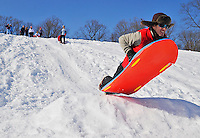 Luke George catches some air after going off of a jump near the top of the hill.  40 people took advantage of the record amount of snow during the Blizzard of 2010 and were sledding Friday afternoon on the big hill behind the Warrenton Aquatic and Recreation Facility (WARF) soccer fields on Friday afternoon 2-12-10 in Warrenton, VA.