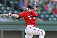 Right fielder Forrestt Allday (15) of the Greenville Drive bats in a game against the Asheville Tourists on Tuesday, July 1, 2014, at Fluor Field at the West End in Greenville, South Carolina. Asheville won, 5-2. (Tom Priddy/Four Seam Images)