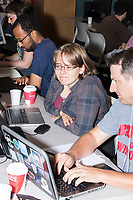 "Chris Cantey, 40, of Saint Paul, Minn., (right) and Mary Solbrig, 28, of Seattle, Wash., work on a project at the Metric Geometry and Gerrymandering Group (MGGG) hackathon at the Data Lab in the Tisch Library at Tufts University in Medford, Massachusetts, USA, on Thurs., Aug. 10, 2017. Cantey is a GIS web developer for the Minnesota State Legislature. Solbrig is a GIS data engineer for Tableau Software in Seattle. Solbrig said she isn't specifically interested in political projects but her Masters thesis at the University of Washington dealt with the mathematical aspects of gerrymandering. She also said the workshop and hackathon was useful because it presented some ""real world challenges of dealing with data, visualizing data, and understanding data. That is very important for the type of work that I do."" They were working on a tool for visualizing district compactness that would also take into account racial metrics and the efficiency gap in voting. The hackathon is part of the first in a series of Geometry of Redistricting workshops put on by the MGGG. Academics, Geographic Information Systems (GIS) professionals, and legal professionals worked together to build tools useful in analyzing voting district data around the country."
