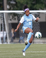 University of North Carolina forward Amber Munerlyn (8) controls the ball.  University of North Carolina (blue) defeated Boston College (white), 1-0, at Newton Campus Field, on October 13, 2013.