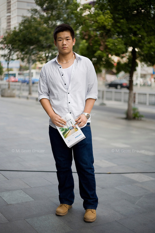Zhangzuohaonan, a student, age 17, poses for a portrait in Nanjing. Response to 'What does China mean to you?': 'A big family.'  Response to 'What is your role in China's future?': 'Common.'