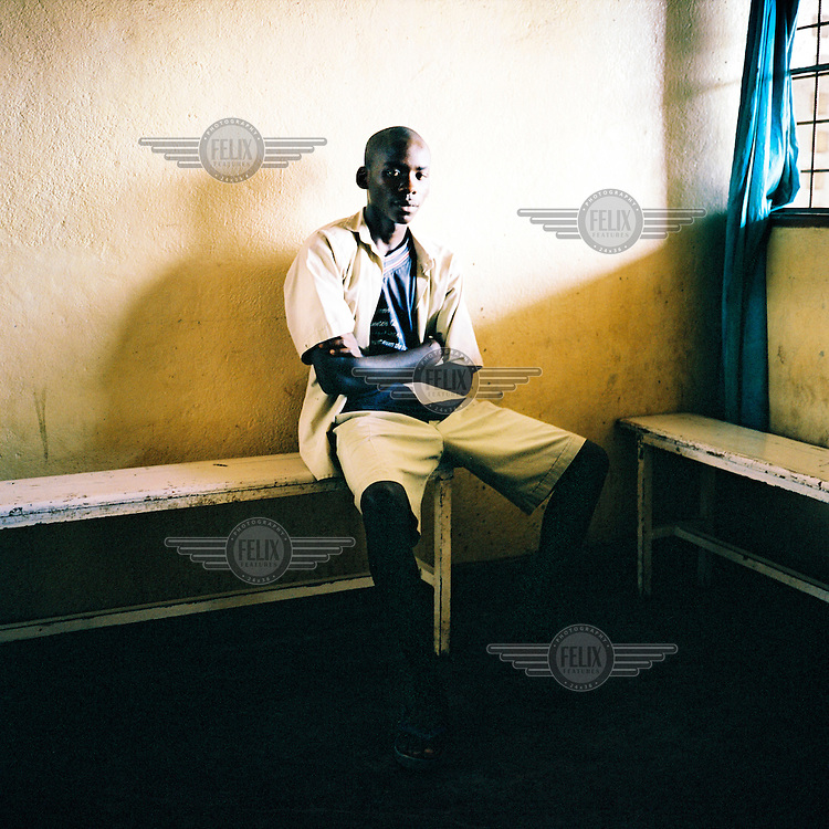 A man waits to see a doctor in a hospital in Bujumbura.