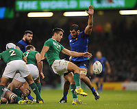Conor Murray of Ireland sends up a box kick despite the attention of Yoann Maestri of France during Match 39 of the Rugby World Cup 2015 between France and Ireland - 11/10/2015 - Millennium Stadium, Cardiff<br /> Mandatory Credit: Rob Munro/Stewart Communications