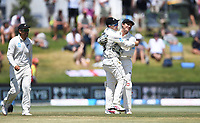 25th November 2019; Mt Maunganui, New Zealand;  Tom Latham celebrates with BJ Watling after taking a catch to dismiss Root International test match day 5 of 1st test, New Zealand versus England;  at Bay Oval, Mt Maunganui, New Zealand.