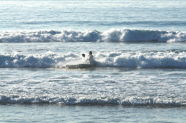 Ocean Kayaker in late afternoon surf