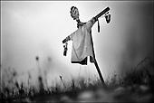Katarzynowo, Northern Poland, December 2005<br /> The faces of Polish poverty<br /> A scarecrow at the forgotten by the state ex-collective farm village. People to make their living collect rubbish from the waste dump<br /> (&copy; Filip Cwik / Napo Images for Newsweek Polska)<br /> <br /> Katarzynowo k. Elku 07<br /> grudzien 2005 Polska<br /> Oblicza biedy w Polsce<br /> Katarzynowo wies w warminsko - mazurskim 20 km od Elku. Typowa po PGR-owska wies zapomniana przez panstwo. Wiekszosc mieszkancow jest bez pracy. Okoliczne wysypisko smieci jest jedynym zrodlem dochodu wiekszosci rodzin. Zbieraja puszki, gume i wszystko co ma jakakolwiek wartosc <br /> <br /> Wiekszosc Polakow niemal / 85% / z trudem radzi sobie z przezyciem od pierwszego do pierwszego. Ponad polowa / 52,5% / zalega ponad trzy miesiace z czynszem. Tyle samo osob, aby poprawic swoja sytuacje materialna radykalnie ogranicza wydatki. W beznadziejnej sytuacji jest ludnosc wiejska gdzie 18,5% zyje w skrajnej nedzy. W 1991 roku rzad polski zlikwidowal Panstwowe Gospodarstwa Rolne ktore od II Wojny Swiatowej byly miejscem pracy dla ponad 2 mln rolnikow glownie na ziemiach odzyskanych. Ci ludzie i ich rodziny nie odnalezli sie w nowej rzeczywistosci<br /> (&copy; Filip Cwik / Napo Images dla Newsweek Polska)