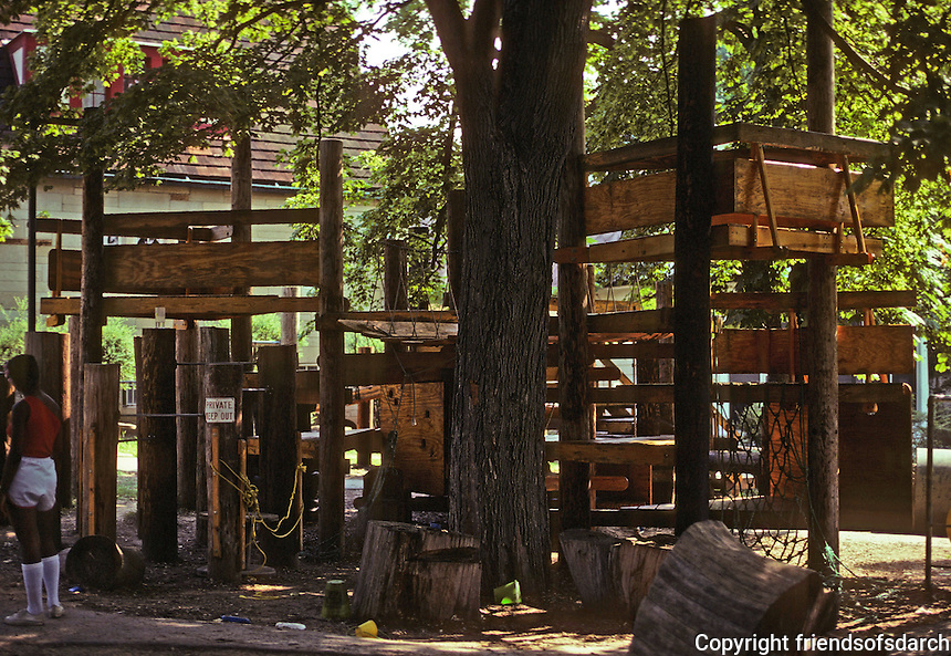 St. Louis: Webster Grove Day Care Center--play structures around a tree. Photo '78.