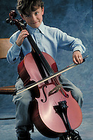 Cello played by a young boy. May not be used in an elementary school dictionary.