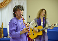 NWA Democrat-Gazette/BEN GOFF &bull; @NWABENGOFF<br /> Armand and Angelina, a classical crossover duo from Orlando, Fla., lead a native american flute 'play shop' on Sunday July 12, 2015 at Unity Church of the Ozarks in Bentonville.
