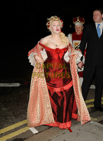 COURTNEY LOVE.Arrives at the fancy dress party reception for Matt Lucas & Kevin McGee following their civil partnership ceremony (wedding) earlier the same day,.Banquetting House, Whitehall, London, England,.17th December 2006..full length funny costume red dress low cut cleavage hair lipstick heart painted on face cheek cardigan jacket gold.CAP/PL.©Phil Loftus/Capital Pictures