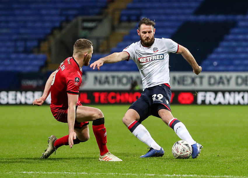 Bolton Wanderers' Jonathan Grounds competing with Walsall's Nicky Devlin<br /> <br /> Photographer Andrew Kearns/CameraSport<br /> <br /> Emirates FA Cup Third Round - Bolton Wanderers v Walsall - Saturday 5th January 2019 - University of Bolton Stadium - Bolton<br />  <br /> World Copyright © 2019 CameraSport. All rights reserved. 43 Linden Ave. Countesthorpe. Leicester. England. LE8 5PG - Tel: +44 (0) 116 277 4147 - admin@camerasport.com - www.camerasport.com
