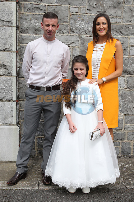 Jessie Behan with her parents Graham and Jill on communion day in Duleek.