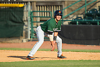 Ryder Jones (15) of the Augusta GreenJackets takes his lead off of first base against the Hickory Crawdads at L.P. Frans Stadium on May 11, 2014 in Hickory, North Carolina.  The GreenJackets defeated the Crawdads 9-4.  (Brian Westerholt/Four Seam Images)
