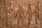 Egyptian inscriptions and symbols carved into the south wall of the Great Hypostyle Hall in the Temples of Karnak, depicting part of the first peace treaty between King Ramses II and his enemies, the Hittites, on the East Bank of Luxor, along the Nile River, Egypt.
