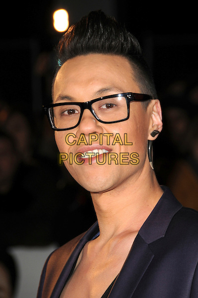 "GOK WAN .Attending the UK Film Premiere of ""Seven Pounds"" at the Empire Cinema, Leicester Square, London, England, January 14th 2009..portrait headshot glasses earring .CAP/CAS.©Bob Cass/Capital Pictures"