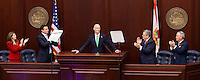 TALLAHASSEE, FLA. 3/4/14-Gov. Rick Scott, center, receives a standing ovation from leaders of the House and Senate during the opening day of the legislative session, March 4, 2014 at the Capitol in Tallahassee. From left, House Speaker Pro Tempore, Marti Coley, R-Marianna, left, Speaker Will Weatherford, R-Wesley Chapel, Senate President Don Gaetz, R-Niceville, second from right, and President Pro Tempore Garrett Richter, R-Naples,  Tempore, right, are with Scott on the dais. <br /> <br /> COLIN HACKLEY PHOTO