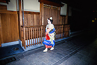Maiko (Apprentice Geisha) on street in Gion District, Kyoto, Japan