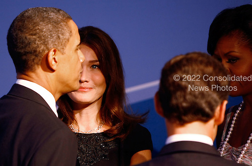 Pittsburgh, PA - September 24, 2009 -- United States President Barack Obama (L) talks with French President Nicolas Sarkozy (2R) and his wife Carla Bruni Sarkozy (2L) while welcoming them to the opening dinner for G-20 leaders with U.S. first lady Michelle Obama (R) at the Phipps Conservatory on Thursday, September 24, 2009 in Pittsburgh, Pennsylvania. Heads of state from the world's leading economic powers arrived today for the two-day G-20 summit held at the David L. Lawrence Convention Center aimed at promoting economic growth.  .Credit: Win McNamee / Pool via CNP