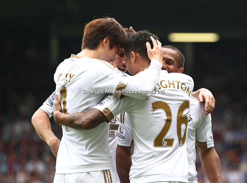 Wayne Routledge of Swansea celebrates scoring the opening goal with team-mates   during the Barclays Premier League match between West Ham United and Swansea City  played at Boleyn Ground , London on 7th May 2016