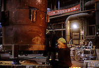 A worker of a state cast steel factory in Tiexi industrial area, Shenyang, northeast China, work in a workshop..20-JAN-02