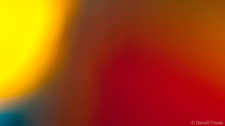 Abstract Photography of warm tone colours blended together to produce the image. The bright yellow is a symbol of the Sun.