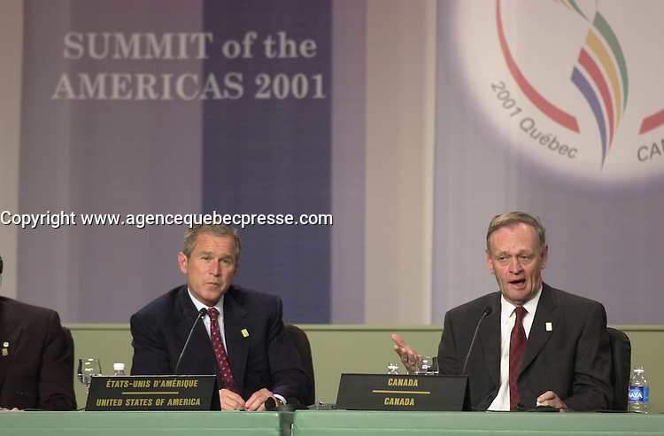April 22,  2001, Quebecl, Quebec, Canada<br /> <br /> George W, Bush, United States of Americas Presidennt (R)  listen while <br /> Jean Chretien, Canada's Prime Minister (L) speak at the closing press conference of the Summit of the Americas , April 22, 2001 in Quebec City, CANADA.