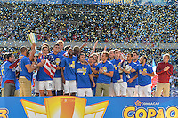 Chicago, IL - Sunday July 28, 2013:   The USMNT head coach Jurgen Klinsmann celebrates with his players and the CONCACAF Gold Cup Trophy after defeating Panama by the score of 1-0 during the CONCACAF Gold Cup Finals soccer match between the USMNT and Panama, at Soldier Field in Chicago, IL.