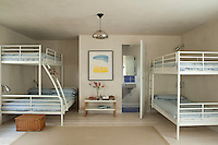 The children's bunk room is on the ground floor and doubles as a den and playroom