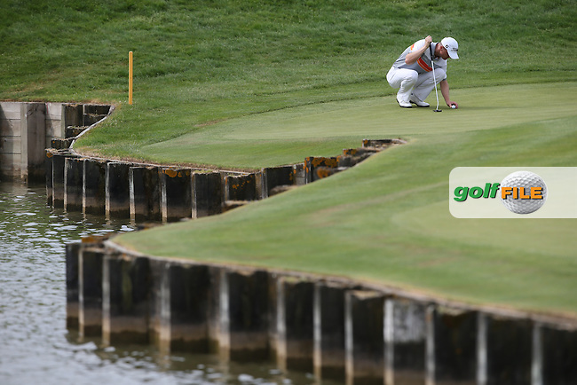 Michael Hoey (NIR) with a lake-side putt on the first hole during the Final Round of the 2015 Alstom Open de France, played at Le Golf National, Saint-Quentin-En-Yvelines, Paris, France. /05/07/2015/. Picture: Golffile | David Lloyd<br /> <br /> All photos usage must carry mandatory copyright credit (&copy; Golffile | David Lloyd)