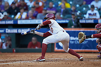 Tanner Tredaway (10) of the Oklahoma Sooners lays down a bunt against the Arkansas Razorbacks in game two of the 2020 Shriners Hospitals for Children College Classic at Minute Maid Park on February 28, 2020 in Houston, Texas. The Sooners defeated the Razorbacks 6-3. (Brian Westerholt/Four Seam Images)