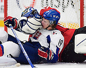 Julius Sinkovic (Val-d'Or - Slovakia) and Reto Berra (GCK Lions Zurich - Switzerland) battle in the crease. The Suisse defeated Slovakia 2-1 in a 2007 World Juniors match on January 2, 2007, at FM Mattson Arena in Mora, Sweden.