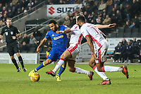 Andy Barcham of AFC Wimbledon is tackled by Scott Wootton of MK Dons as he tries to shoot during the Sky Bet League 1 match between MK Dons and AFC Wimbledon at stadium:mk, Milton Keynes, England on 13 January 2018. Photo by David Horn.