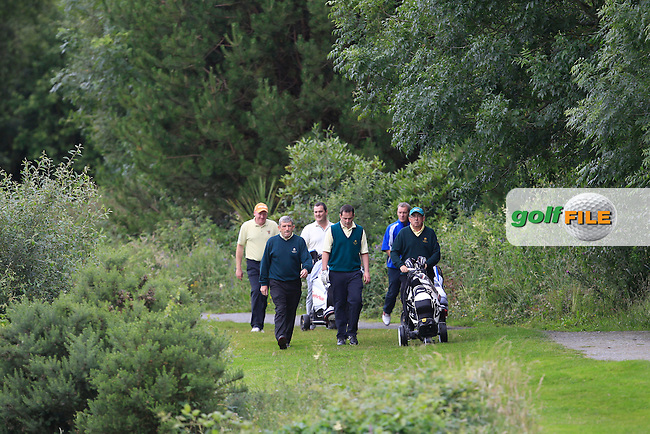 Walking to the 13th green during the Final round of the Munster section of the AIG Pierce Purcell Shield at East Clare Golf Club on Sunday 19th July 2015.<br /> Picture:  Golffile | Thos Caffrey