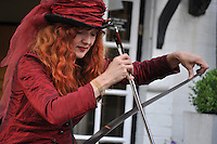 Caroline the Musical Saw Lady busking at The George Hotel. Bunkfest, 2014, Wallingford.