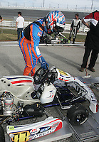 Indy Car driver Dan Wheldon pushes his go-cart onto the scales after winning his race at Daytona International Speedway on Wednesday, December 30, 2009. (Photo by Brian Cleary/www.bcpix.com)