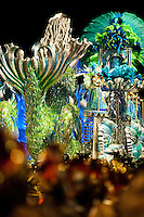 Dancers of Portela samba school perform atop a float during the Carnival parade at the Sambadrome in Rio de Janeiro, Brazil, 20 February 2012. The Carnival in Rio de Janeiro, considered the biggest carnival in the world, is a colorful, four day celebration, taking place every year forty days before Easter. The Samba school parades, featuring thousands of dancers, imaginative costumes and elaborate floats, are held on the Sambadrome, a purpose-built stadium in downtown Rio. According to costumes, flow, theme, band music quality and performance, a single school is declared the winner of the competition.