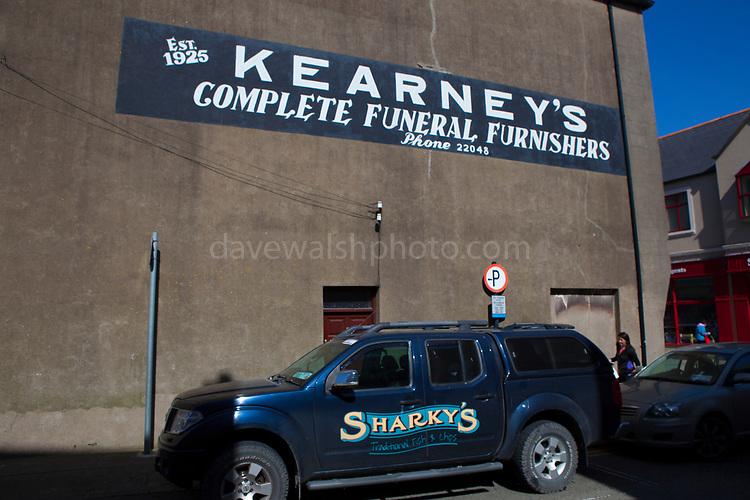 Kearney's undertaker - end of building painting in Selskar, in Wexford, Ireland
