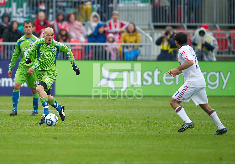 25 April 2010: Seattle Sounders midfielder Freddie Ljungberg #10 takes the ball up field during a game between the Seattle Sounders and Toronto FC at BMO Field in Toronto..Toronto FC won 2-0....
