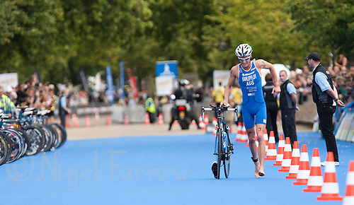 15 AUG 2009 - LONDON, GBR - Brad Kahlefeldt limps into transition - ITU World Championship Series Mens Triathlon.(PHOTO (C) NIGEL FARROW)