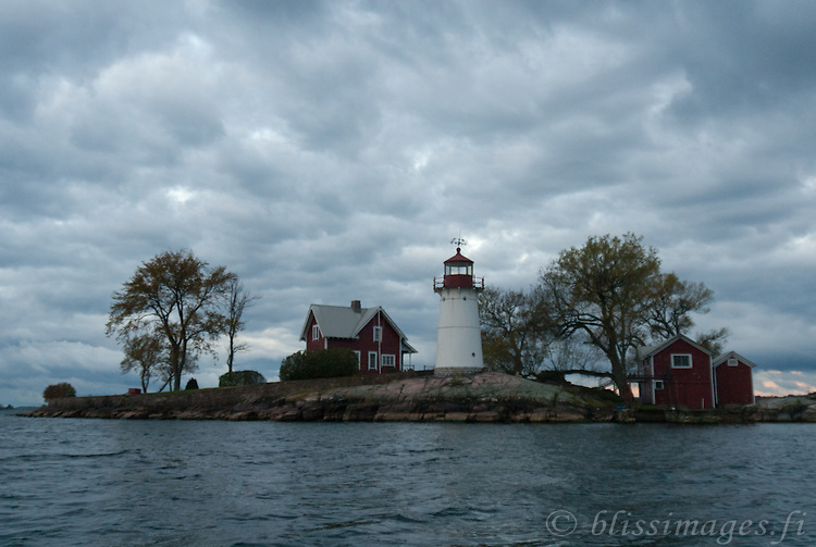 Storm clouds threaten at dawn over Crossover Island Lighthouse in the St. Lawrence River's 1000 Islands.